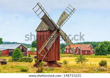 Windmill in a old vintage rural landscape. From the island Åland, Finland - stock photo