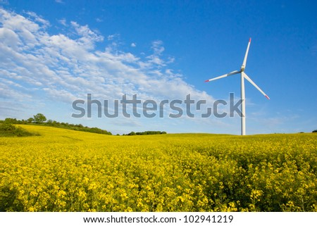 Windmill in  field - stock photo