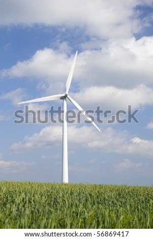 Windmill in green field