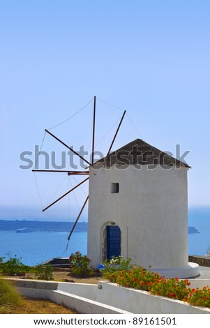 Windmill in Oia at Santorini island, Greece - vacation background