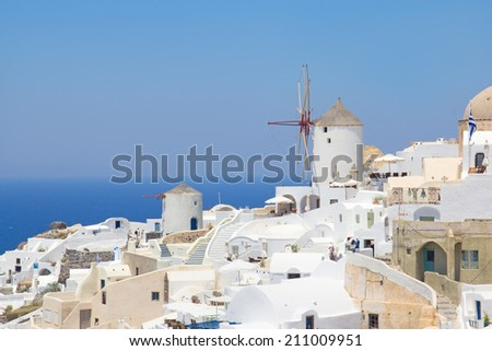 windmill in Oia village on island of Santorini, Greece - stock photo
