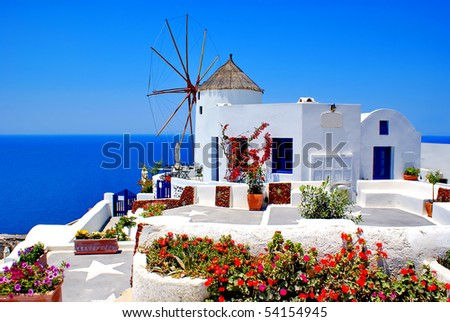 Windmill in Oia village on Santorini island, Greece - stock photo