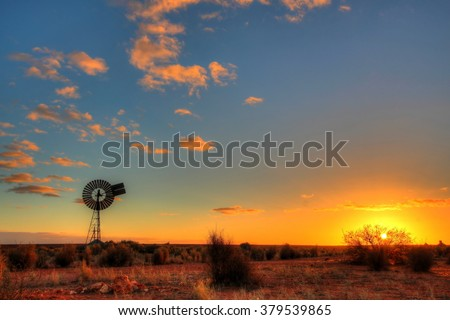 Windmill in remote Australian outback - stock photo