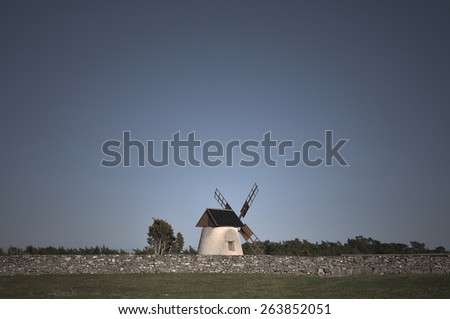 Windmill in spring monochromatic colors. - stock photo