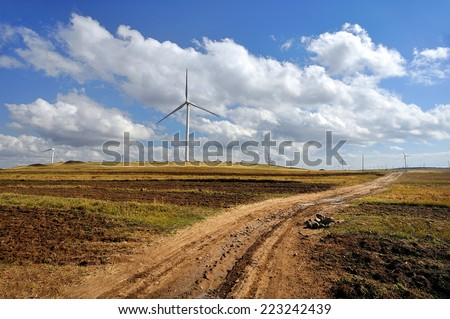 windmill in the field - stock photo
