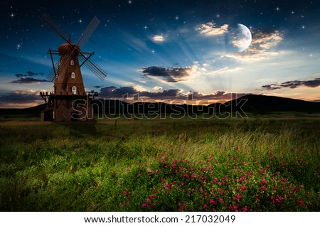 Windmill in the night. Elements of this image furnished by NASA.