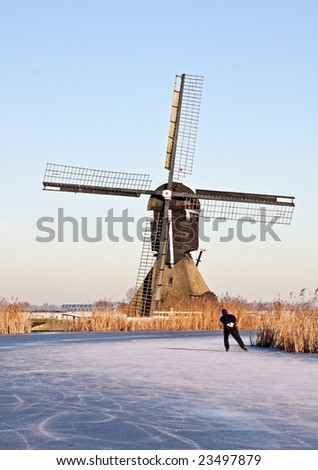 Windmill in wintertime in the Netherlands - stock photo