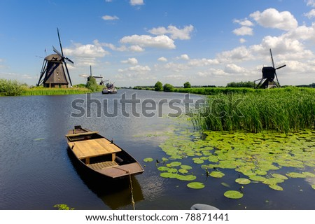 Windmill landscape at Kinderdijk near Rotterdam The Netherlands - stock photo