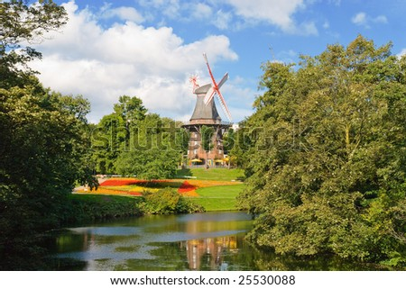 Windmill near a river in Bremen, Germany - stock photo