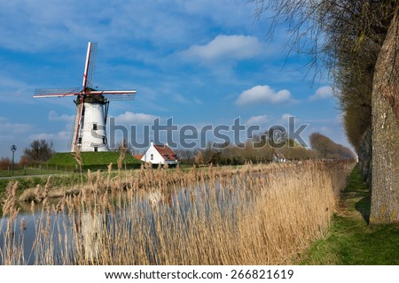 Windmill of Damme, one of the most beautiful villages in Flanders Belgium, near Bruges, along the canal Damse Vaart - stock photo
