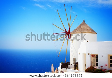 windmill of Oia at sunny day close up, Santorini, toned - stock photo