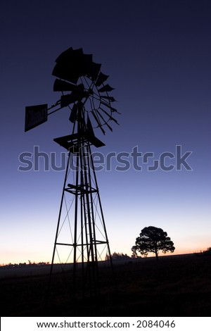 Windmill on a hill at sunset