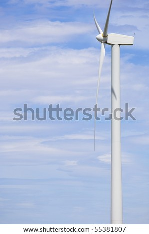 windmill on a sunny day and with idyllic white clouds - stock photo