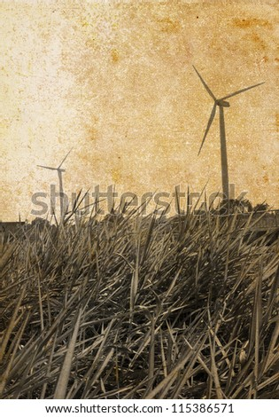 Windmill on a textured vintage paper background with grunge stains. - stock photo
