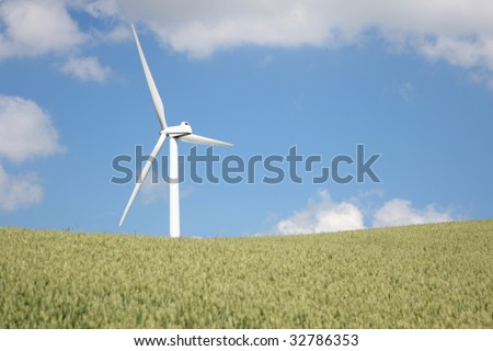 Windmill on a wheat field in Jutland, Denmark on a sunny summer day.