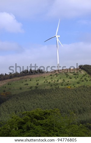 windmill on lush irish countryside landscape in glenough county tipperary ireland