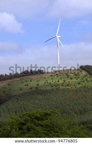 windmill on lush irish countryside landscape in glenough county tipperary ireland - stock photo