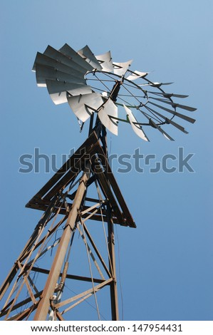 Windmill on the Darling Downs, Queensland, Australia. Windmills are commonly used for pumping water from bores or dams to troughs for livestock.