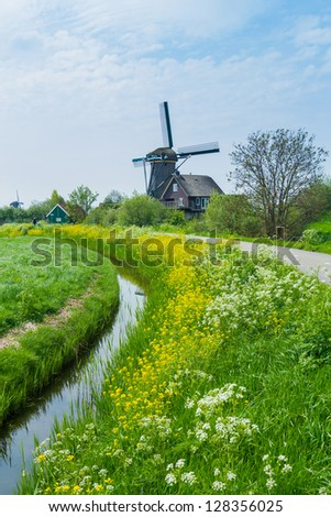 Windmill on the outskirts of Amsterdam. Holland the Netherlands. Vertical view - stock photo