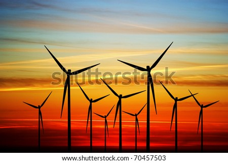 Windmill on the sunset - stock photo