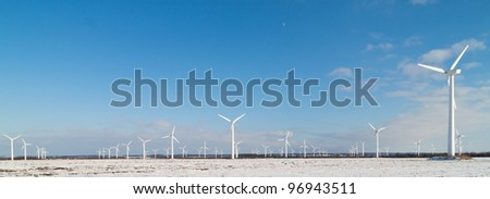 Windmill park in snowy landscape - stock photo