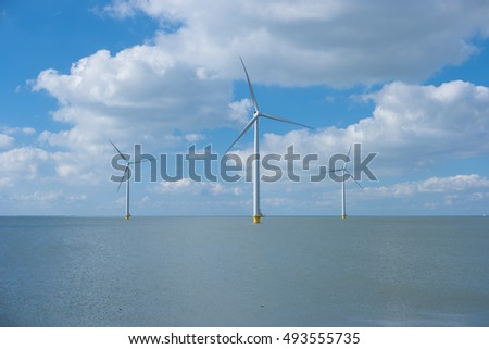 Windmill park Westermeerdijk the largest wind farm in the Netherlands.  The wind farm produce 1.4 TWh of electricity. Urk, Flevoland, Netherlands October 2016, Three isolated windmills
