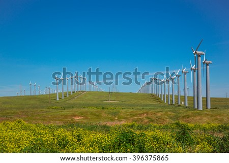 Windmill power generators during a sunny day - stock photo