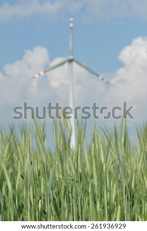 Windmill, production of green energy. Masts with blades