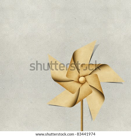 windmill recycled papercraft on paper background - stock photo