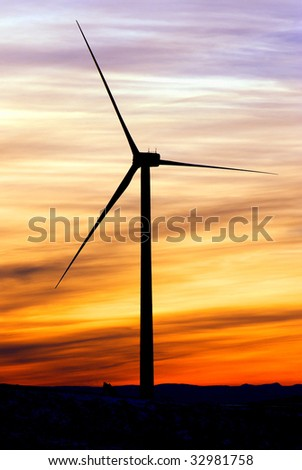 Windmill silhouette at sunset - stock photo