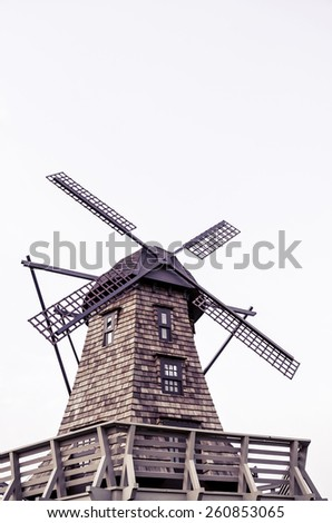 Windmill standing in white isolated background - stock photo