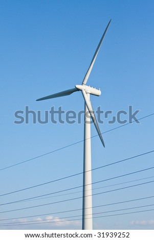 windmill together with high voltage powerlines