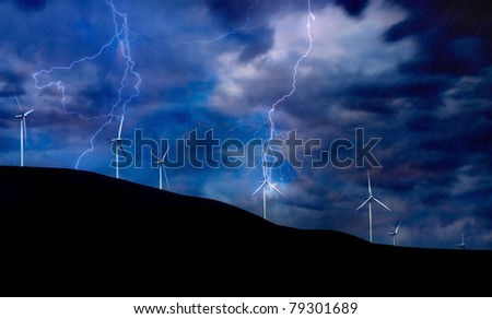 Windmill Turbines Generating Electricity during a Thunder Storm - stock photo