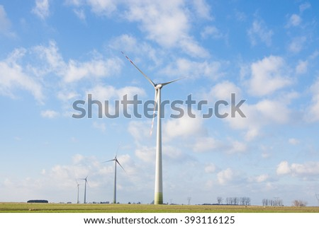 windmill wind power plant - on the field