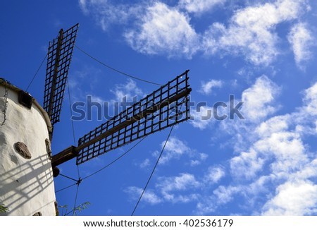 Windmill wings against a blue sky with clouds. Tenerife,Canary Islands,Spain.