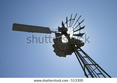 Windmill with sun behind it