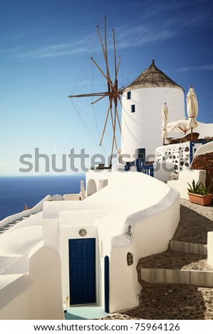 Windmill with view on Santorini Island (Oia village). - stock photo