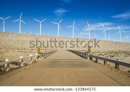 Windmills Across A Bridge - stock photo