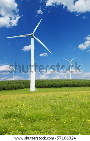 Windmills against a blue sky at sunny day - stock photo