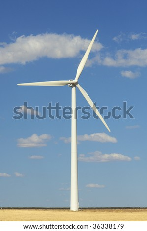 windmills against blue sky with clouds - stock photo