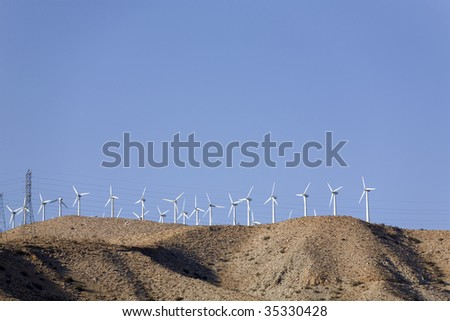Windmills against Electric Power Lines - stock photo