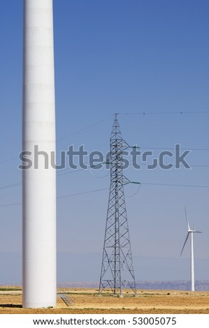 windmills and power line with a clear blue sky - stock photo