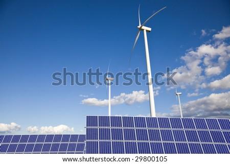 Windmills and solar panels - stock photo