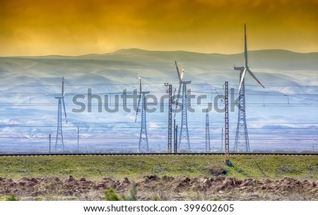 Windmills and sunset. Alternative and ecological energy source. the golden sunset at the wind-power station - stock photo
