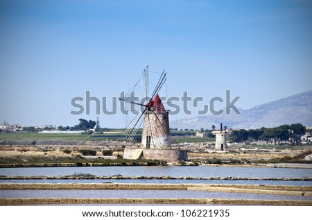 Windmills and the oldest Europe's salt ponds in Sicily, Italy, between Marsala and Trapani - stock photo