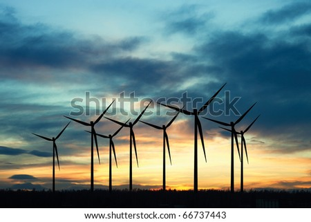 Windmills at sunset - stock photo
