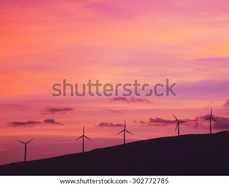 Windmills at Sunset. Green Energy Future. Clean Technology.