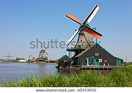 Windmills at the famous Zaanse Schans near Amsterdam, Netherlands - stock photo