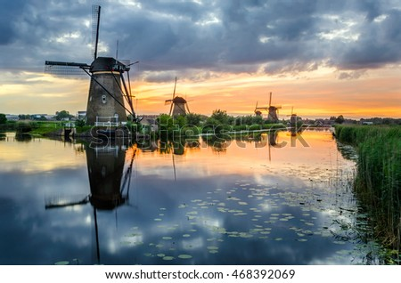 Windmills at the UNESCO Site of Kinderdijk at Sunset