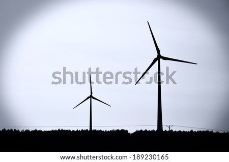 Windmills conceptual image. - stock photo